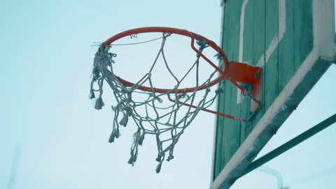 Old Basketball net on outdoor court. Close-up 4k UHD (3840x2160)