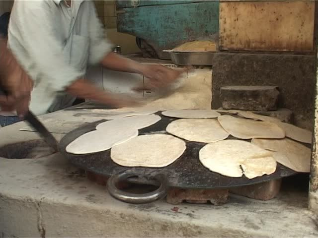 Indians cooking chapati
