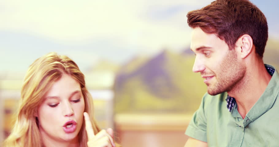 Front view close up of pretty Caucasian couple arguing in a store