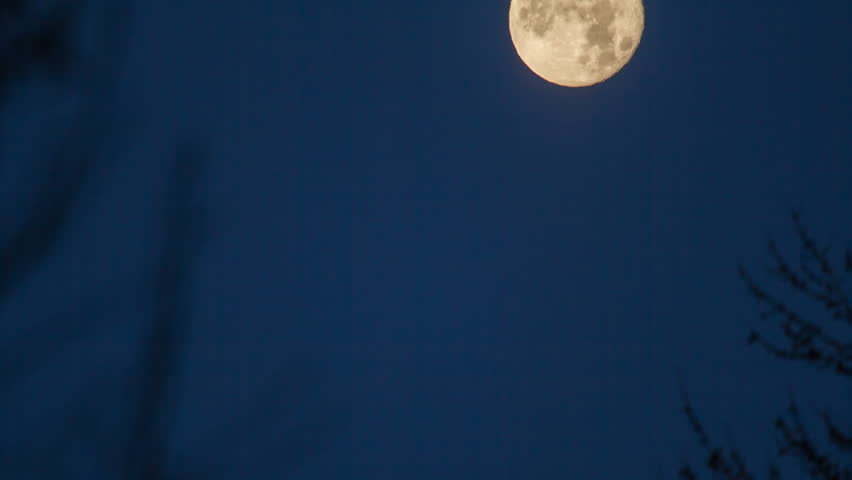 Time lapse of a full moon moving through the frame as clouds move by on this winter morning in Utah. | Shutterstock HD Video #14976667