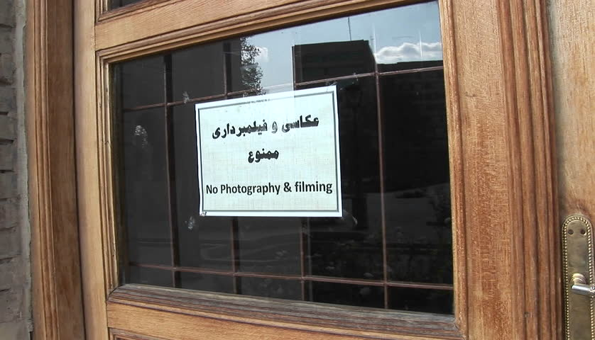 A sign on a window in Iran warns visitors that photography and filming in prohibited.