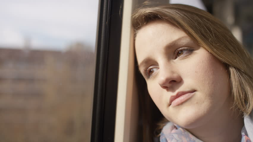 4K Young woman relaxes on a train whilst looking out the window, in slow motion | Shutterstock HD Video #14999587