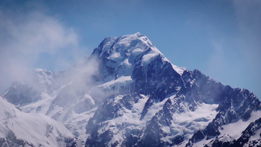 Close up pf Mount Cook above the clouds. Tight shot.