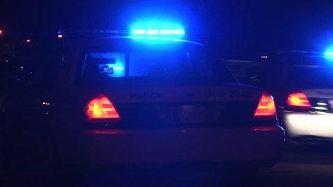 Police arrive at a scene at night POV