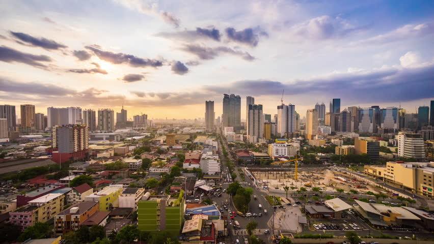 Timelapse of sunset over Metro Manila transitioning to night, Philippines