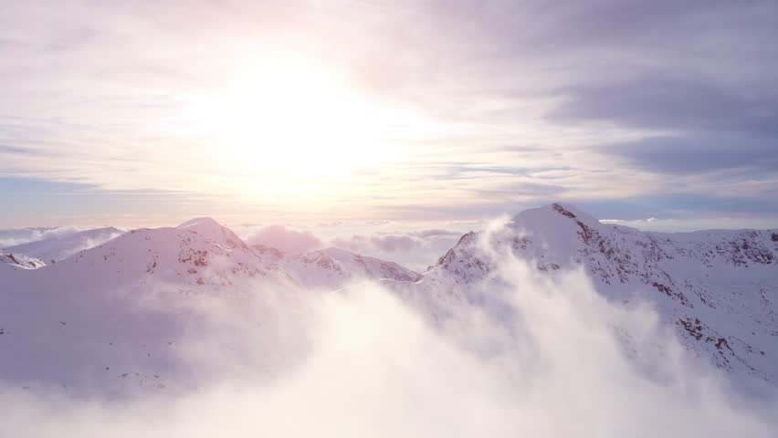 Epic Aerial Flight Through Mountain Clouds Towards Sunrise Beautiful Morning Peaks Inspirational Motivational Nature Background UHD 4K | Shutterstock Video #15072076