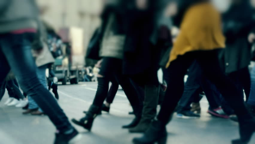 Big city crowd/people mingle cross paths intersection slow motion 100p.gimbal stabilized tracking shot of an anonymous crowd of pedestrianswalking/crossing a busy city street.No logos or faces visible | Shutterstock HD Video #15079147