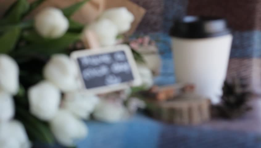 Have a nice day! Coffee to go. Chalkboard. White tulips.    Shutterstock HD Video #15086587