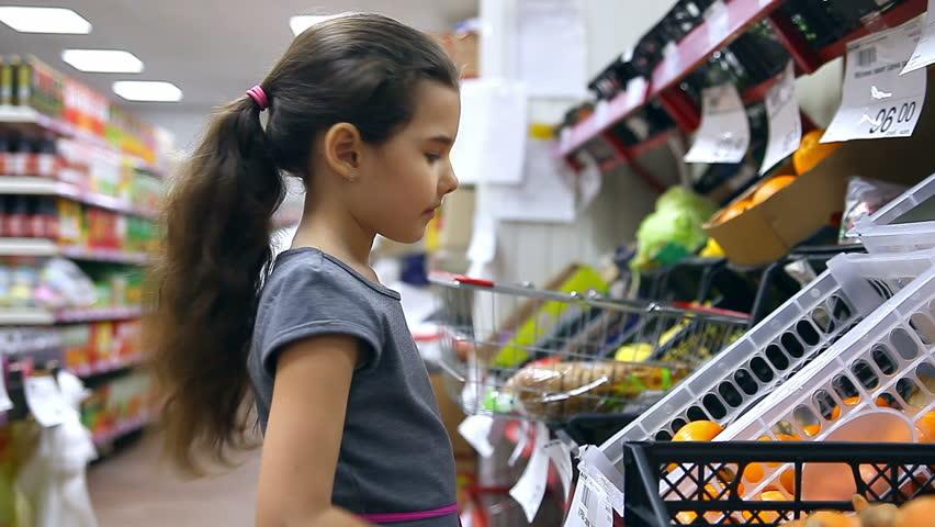 Girl teen  in supermarket to buy persimmon fruit food  | Shutterstock HD Video #15103237