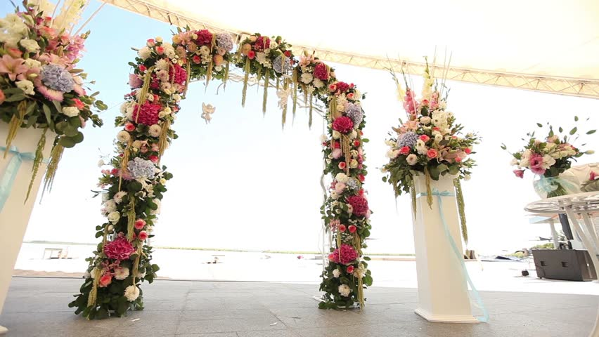Wedding decorations on the beach wedding interior ceremony wedding decorations on the beach wedding interior ceremony wedding arch flower arch outside stock footage video 15111187 shutterstock junglespirit Choice Image