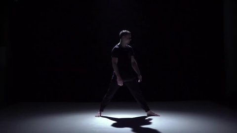 Start graceful contemporary dance of couple dancers on black, shadow, slow motion