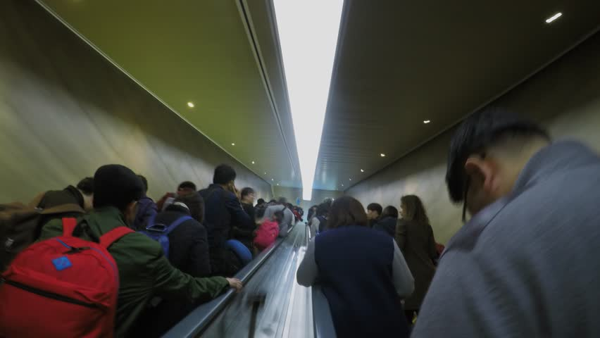 SHANGHAI - NOV 05, 2015: Many people movement on escalator and tunnel. Timelapse #15192607