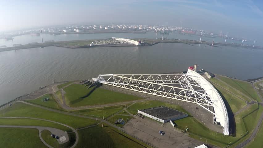 Aerial of north side of Maeslantkering Maeslant barrier part of Delta Works Delta Werken Deltaworks drone UAV cockpit view storm surge barrier Rotterdam harbour and one of largest moving structures 4k
