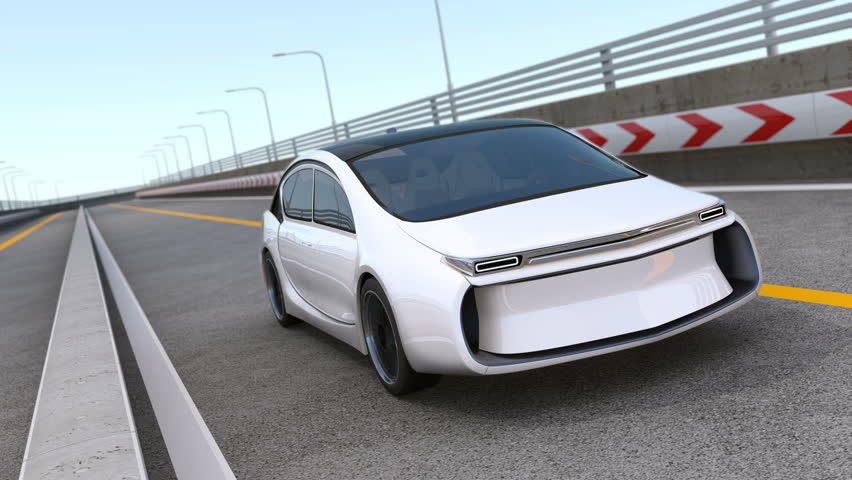 White electric car driving on highway