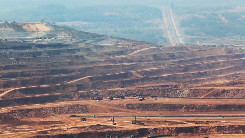 Mining dump trucks working in Lignite coalmine lampang thailand  | Shutterstock HD Video #15201877