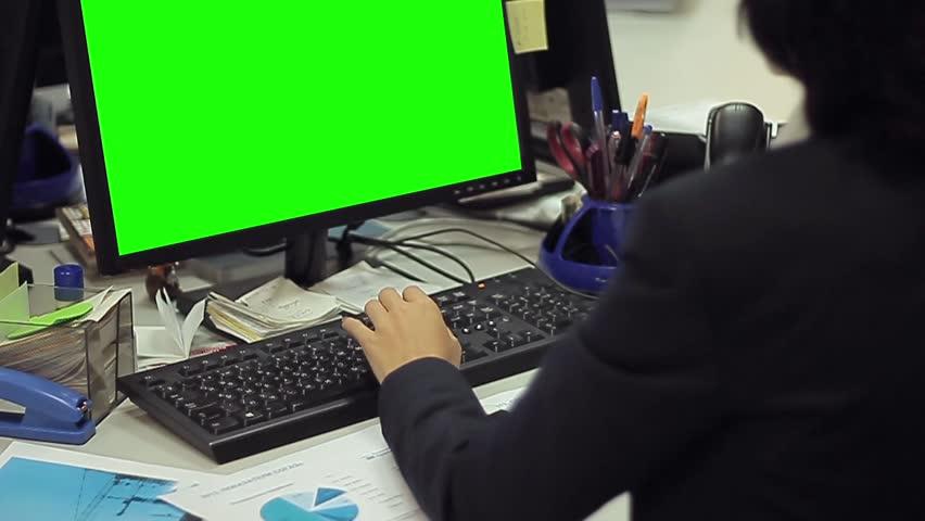 Woman using computer with green screen | Shutterstock HD Video #15210757