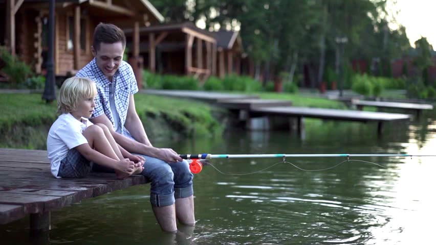 Dad and son fishing outdoors | Shutterstock HD Video #15211297