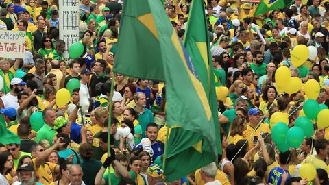 SAO PAULO, BRAZIL - MARCH 13, 2015: Large crowds of people protesting against Brazilian corruption and wanting the impeachment of president Dilma Rousseff and the removal of her political party PT.