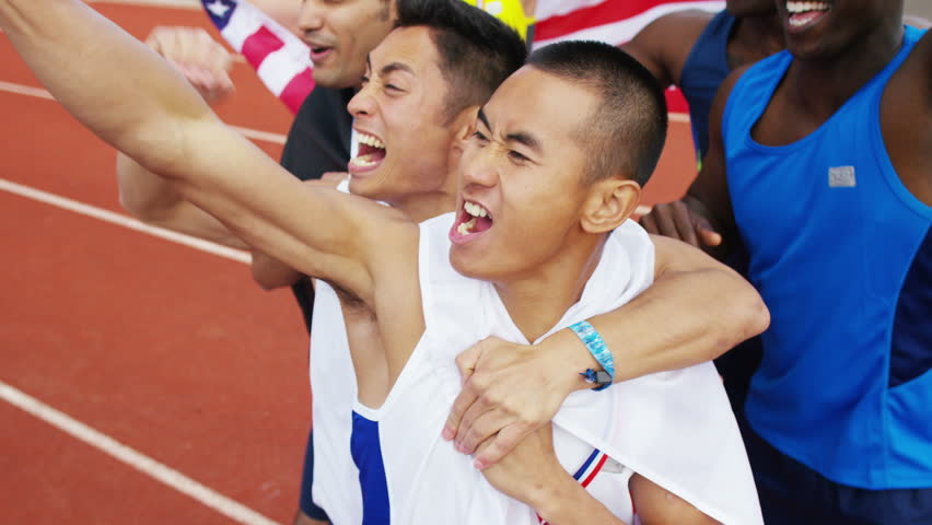 4K Group of athletes (disabled & able bodied) celebrate victory on running track