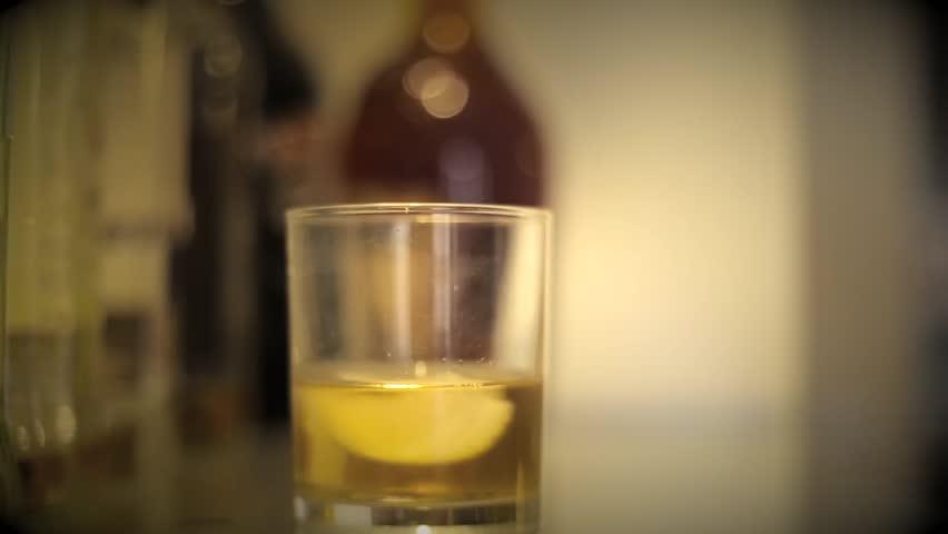 Shot of Putting Date rape drug in a drink