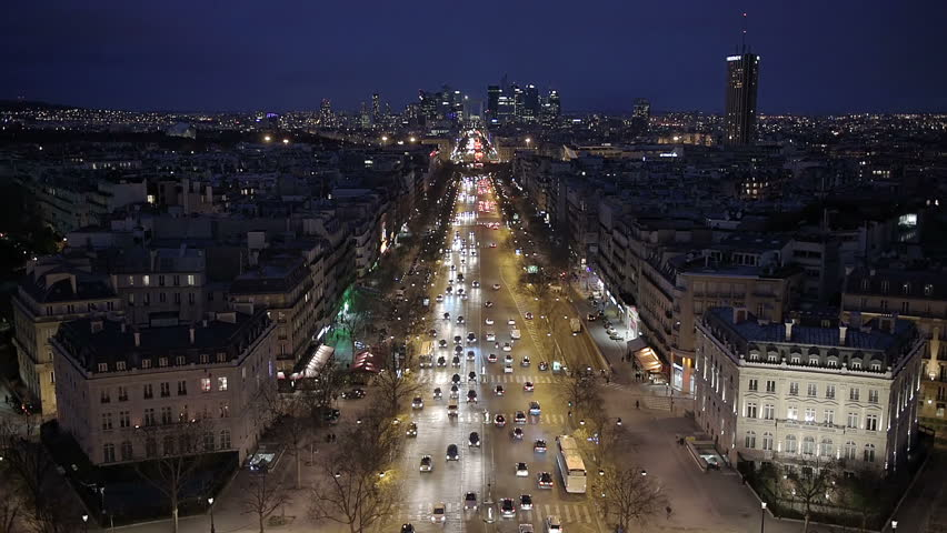 Aerial night view of Paris from the top of the Arc de Triomphe along the La Grande Armee boulevard towards the financial and business district of La Defense | Shutterstock HD Video #15323887