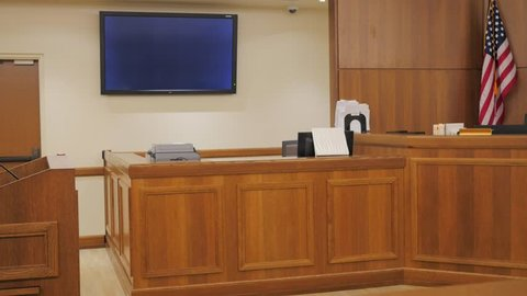A side view of the courtroom looking at the clerk's desk and the judges Bench.
