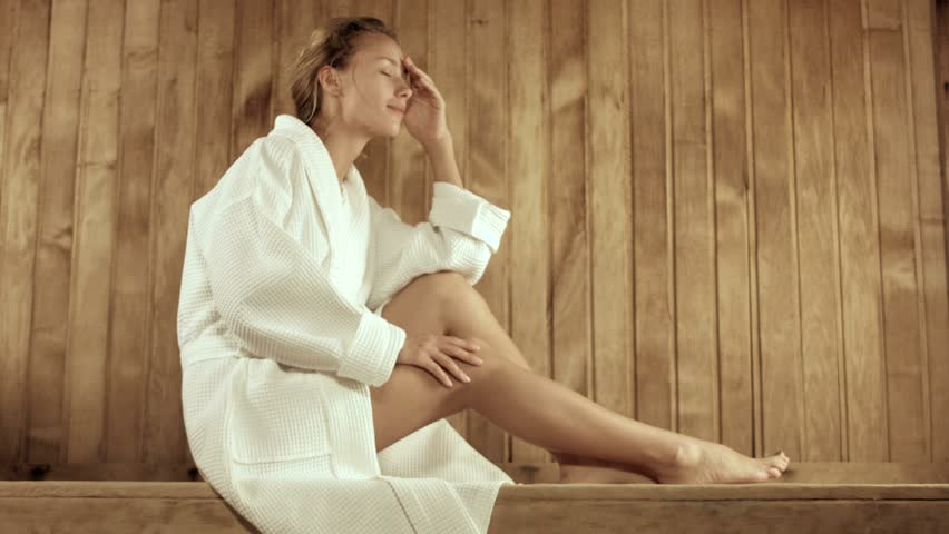 Rest of a young woman in the spa complex in the sauna