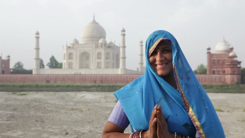 Indian Woman in traditional Sari in front of Taj MahalIndian Woman in traditional Sari in front of Taj Mahal, Agra, Uttar Pradesh, India