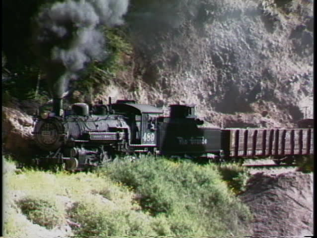 COLORADO, USA - CIRCA 2009: A Rio Grande steam engine pulling a freight train through the Rocky Mountains ountains circa 2009 in Colorado.