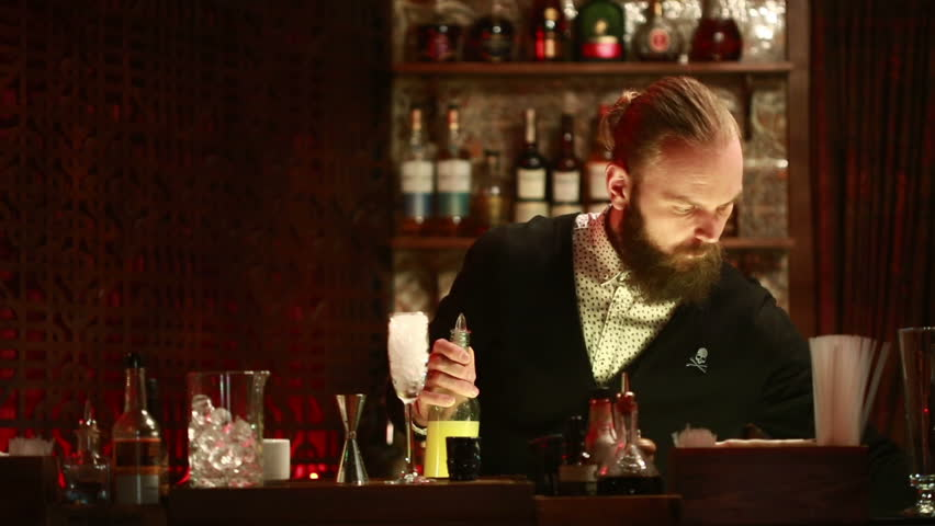 Handsome barman professional at posh bar making cocktail drinks #15359704