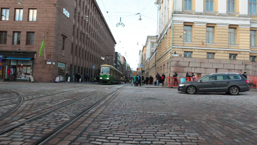 HELSINKI, FINLAND - CIRCA, DEC, 2015: Green streetcar drives on the Aleksanterinkatu street near the Senate Square in city. Public passenger ecological transport is in capital of Finland. Sound  | Shutterstock HD Video #15375967
