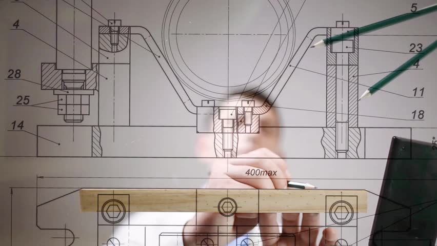 Drawings are on the desktop, hands of engineer drawing by pencil  | Shutterstock HD Video #15390130