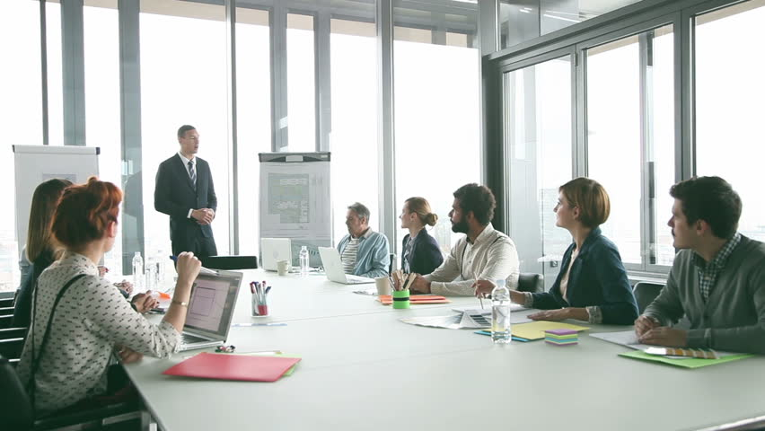 Colleagues applauding director during a meeting in conference room | Shutterstock HD Video #15414727