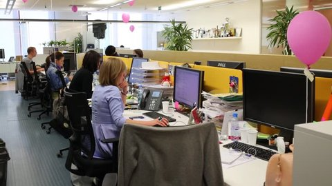 MOSCOW - JUN 03, 2015: Young people work with computers in Tinkoff Bank office. Tinkoff Bank - only full online bank in Russia
