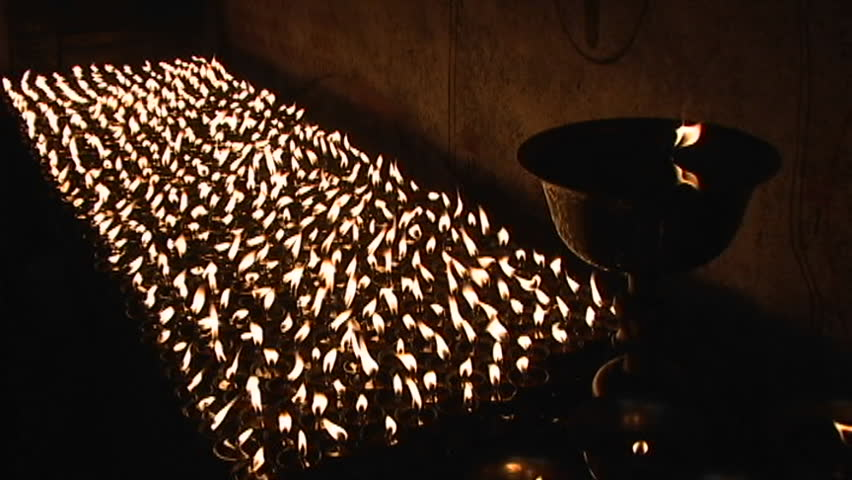 Buddhist candles burn inside a small temple circa 2005 in Kathmandu.