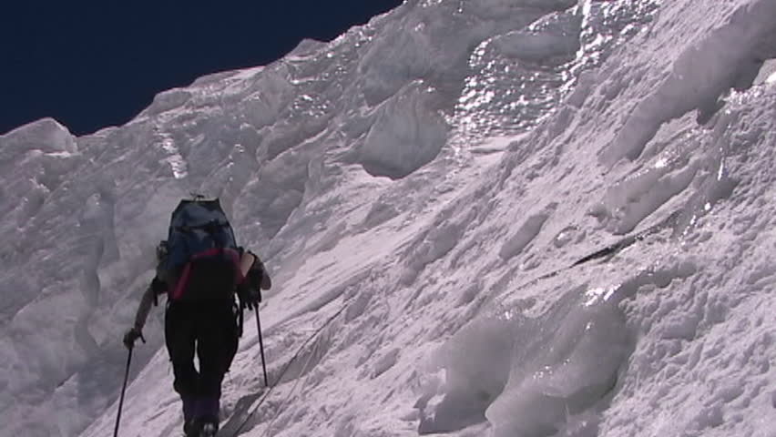 Climber ascends a vertical, icy slope circa 2005 in Tibet.