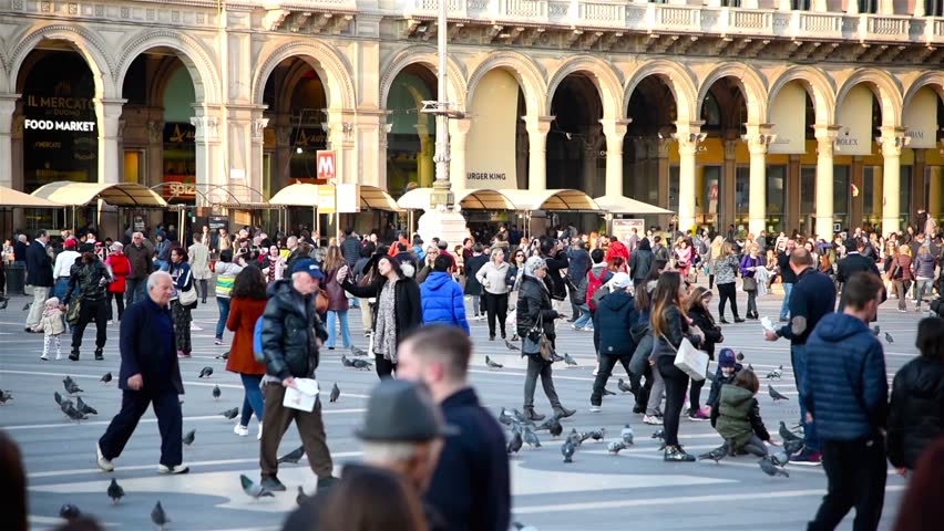 Traffic of people Rush Hour in center of Milan in slow motion Duomo di Milano 21/03/2016