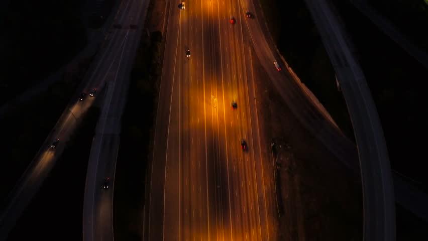 Atlanta Aerial v228 Vertical shot following over Spaghetti Junction freeways at night.