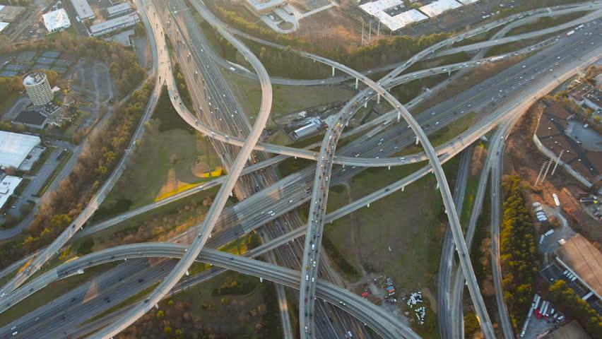 Atlanta Aerial v215 Flying vertical shot over Spaghetti Junction freeways panning up at sunset.