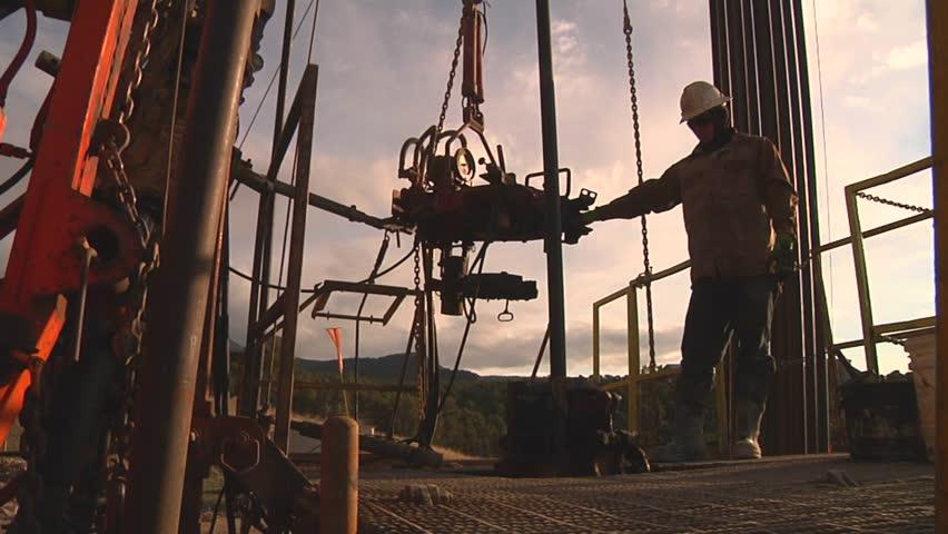 Drilling Rig work floor with worker / North Dakota - March, 2014