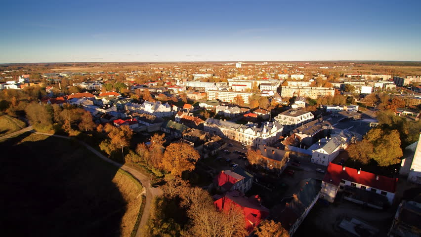 The aerial view of the buildings and houses in the city. The city where the ruined Rakvere castle is found in the hill | Shutterstock HD Video #15527377