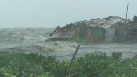 Storm Surge Flood Water Inundates Shanty Houses In Manila During Tropical Storm.
