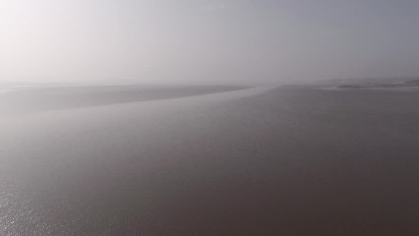 Aerial view of Scottish beach at low tide in the morning haze.