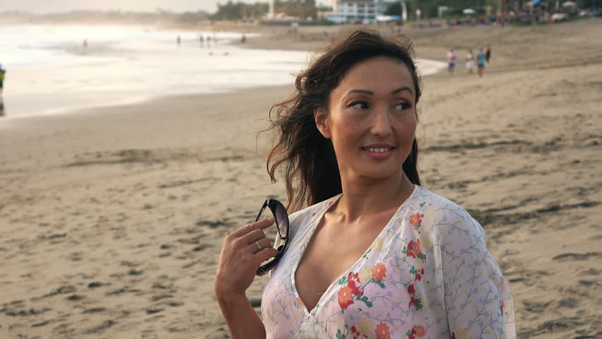 Happy, young woman admire view on beach    Shutterstock HD Video #15572977