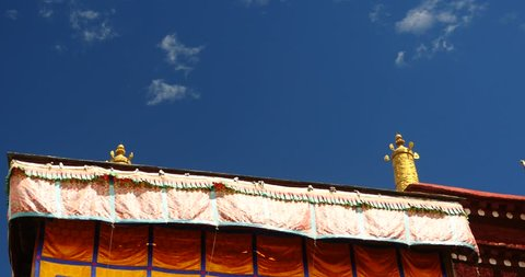 4k closeup of The Jokhang Temple In Lhasa,Tibet,white clouds in blue sky. gh2_09660_4k