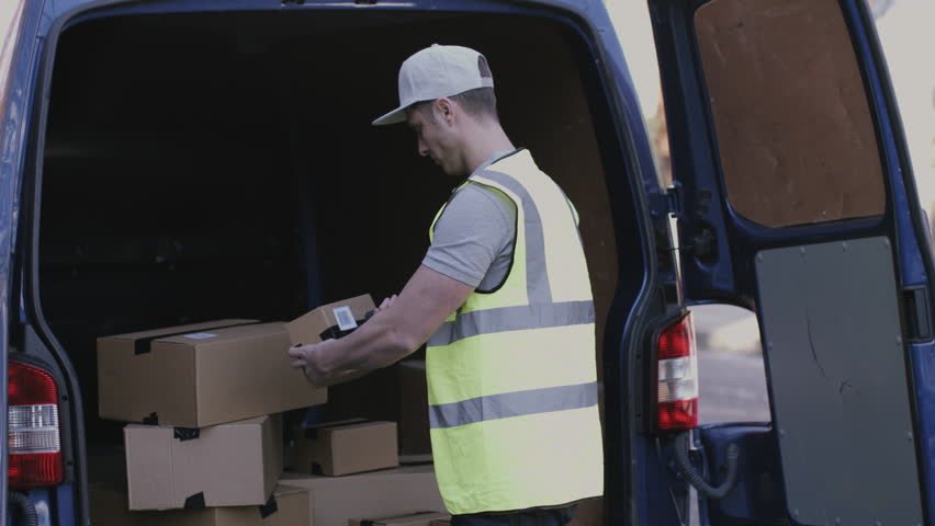 Delivery Man Scanning Boxes with Stock Footage Video (100% Royalty-free)  15604927 | Shutterstock