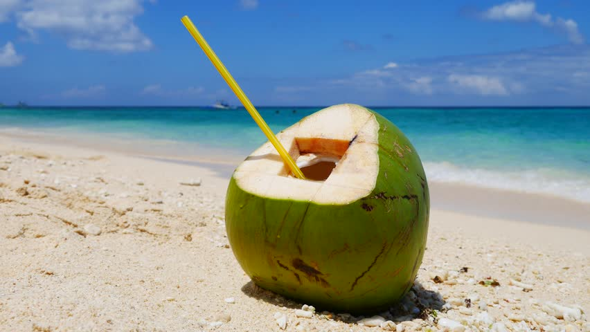 Ready To Drink Coconut On A Sand Of The Tropical Beach In UHD