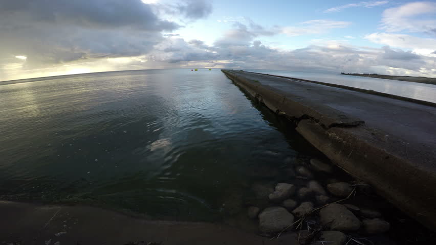 Dramatic landscape with cement pier in Curonian Lagoon on sunny cloudy morning, 4K  #15678037