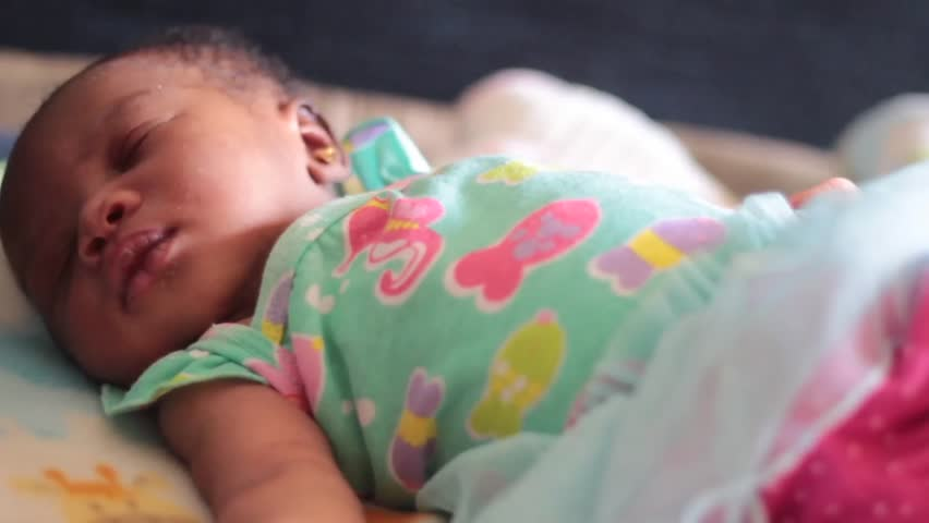Medium of Cute Week Old Baby as she sleeps and flutters her lashes