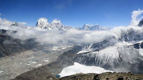 A time lapse video of clouds moving above Gokyo village and frozen lake in the Khumbu area of Nepal near Mt Everest. The peak is Cholatse (5440) and the video is shot from the Gokyo Ri view point.